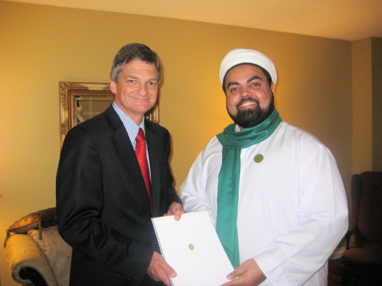 Sayyid Ahmed Amiruddin with Hon. Attorney General Chris Bentley, MPP