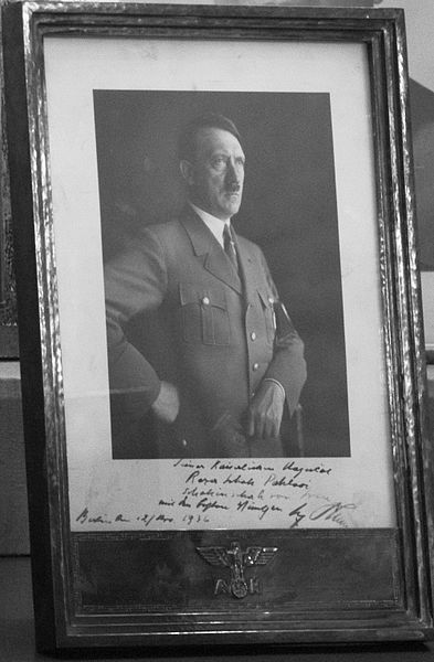 Signed Photograph of Adolf Hitler for Reza Shah Pahlavi in Original Frame with the Swastika and Adolf Hitler's (AH) Sign – Sahebgharanie Palace – Niavaran Palace Complex. The text below the photograph: His Imperial Majesty – Reza Shah Pahlavi – Shahanshah of Iran – With the Best Wishes – Berlin, 12 March 1936 – The signature of Adolf Hitler