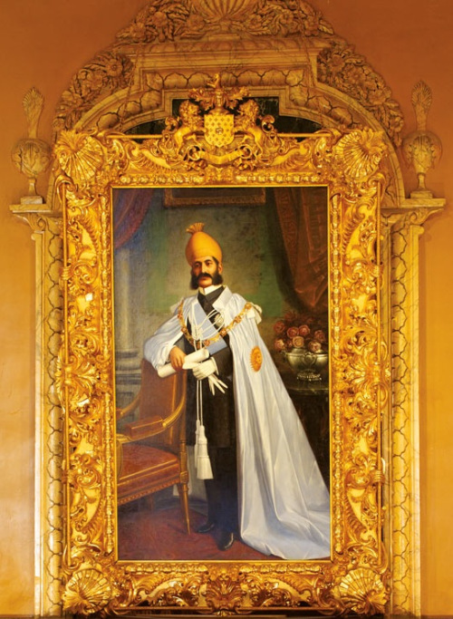 Portrait of Asaf Jah VI Mir Mahbub Ali Khan Siddiqi (August 17, 1866 – August 29, 1911) the 6th Nizam of Hyderabad, inside Falaknuma Palace. He ruled Hyderabad State between 1869 and 1911.  He was a direct descendant of the first Caliph ʿAbd Allāh ibn Abī Quḥāfah, (c. 573 CE – 634 CE) also known as Abū Bakr al-Siddiq.