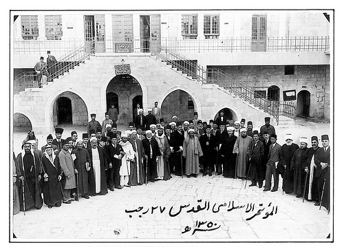 Leaders attending the World Islamic Congress, Jerusalem, 1931. From right, Riyad al-Sulh, a prime minister of Lebanon, fourth, Mawlana Shawkat Ali, leader of the Indian Khilafat movement, ninth from right is Hajj Amin; third from left is Shukri al-Quwatly, a President of Syria. © Ahmad al-Ansari.